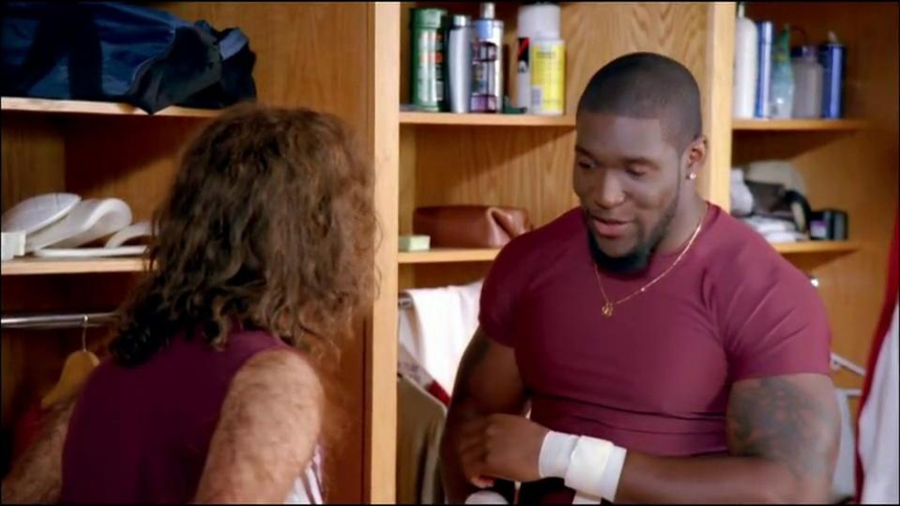 GEICO TV Spot, 'Cheerleader Caveman' Featuring Brian Orakpo - Screenshot 3