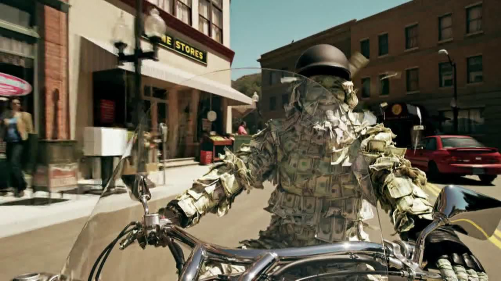 GEICO Motorcycle Money Man TV Spot, 'Driving Through' - Screenshot 5
